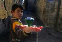 Topaç ve Çocuk... - Fotoğraf: Ahmet Mengüç